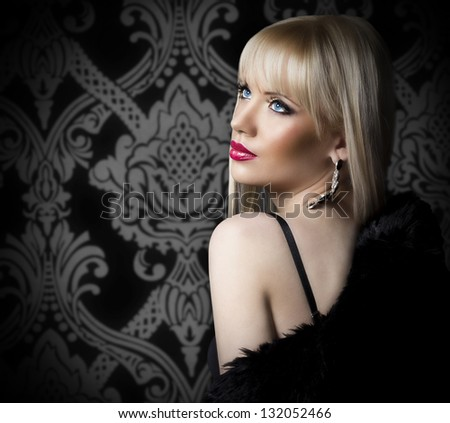 Beautiful blonde woman in luxury fur coat - stock photo