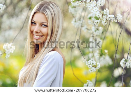 Beautiful blonde woman in spring - stock photo