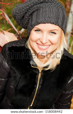 Beautiful blonde woman in the autumn park - stock photo