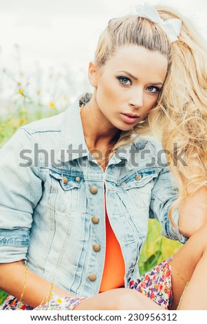 beautiful blonde woman . outdoor lifestyle portrait of a girl - stock photo