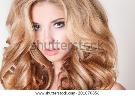 Beautiful blonde woman portrait, beauty girl with long blond curly hair, beauty and fashion model bright makeup woman. isolated on white, studio. series - stock photo