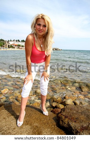 Beautiful blonde woman relaxing on the beach - stock photo