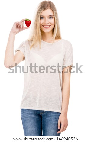 Beautiful blonde woman smiling and holding strawberries, isolated over white background - stock photo