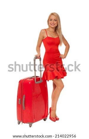 beautiful blonde woman wearing dress with big red suitcase isolated on white  - stock photo