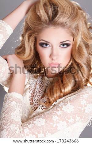 Beautiful blonde woman with perfect skin, curly hairstyle and bright makeup, skincare, spa, cosmetology. Sexy vogue woman face. Natural look. studio, isolated.