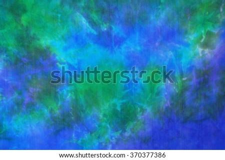 Beautiful blue and green tie dye silk fabric background - stock photo