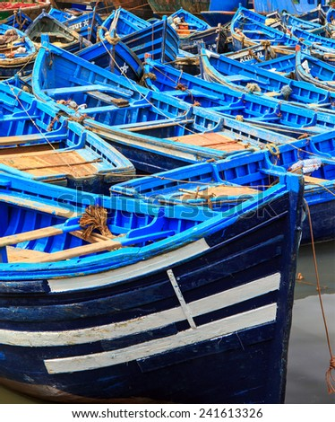 Beautiful blue boats in old Essaouira harbor, Morocco - stock photo