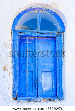 Beautiful blue colored wooden window in a house in Langada a village of Amorgos island in Greece - stock photo