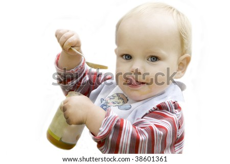 Beautiful blue eyed blond baby eating apple sauce with a spoon isolated in white - stock photo