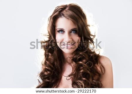Beautiful blue eyed brunnete happily smiling - stock photo