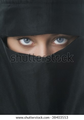 Beautiful blue eyed woman in traditional Niqab veil - stock photo
