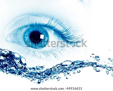 Beautiful blue eyes. on macro - stock photo