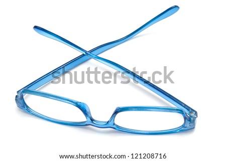 Beautiful blue glasses closeup on white background - stock photo