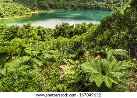 Beautiful blue lake found near the Poas Volcano in Costa Rica. - stock photo
