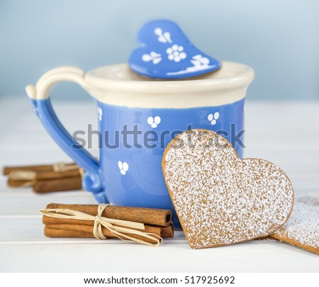 Beautiful blue mug and gingerbread cookie