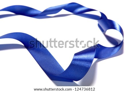 beautiful blue ribbon from fabric. Isolated on a white background - stock photo