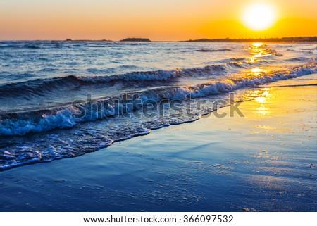 beautiful blue sea at the sunset - stock photo