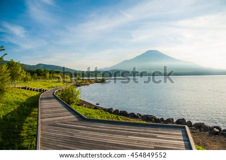 Beautiful blue sky and mountain Fuji with wooden sidewalk in summer at Yamanakako Lake, Kawaguchiko, Japan.