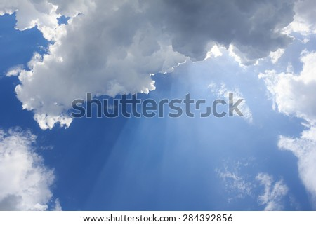 Beautiful Blue sky with clouds and sun reflection - stock photo