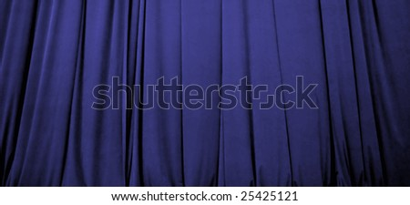 Beautiful blue stage curtain with soft focus - stock photo