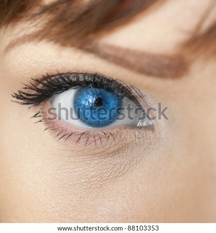Beautiful blue woman eye closeup - stock photo