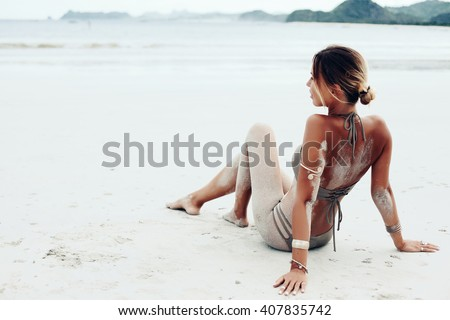 Beautiful bohemian styled and tanned girl at the beach - stock photo