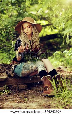 Beautiful boho style girl in the wild wood. Boho, hippie fashion shot. - stock photo