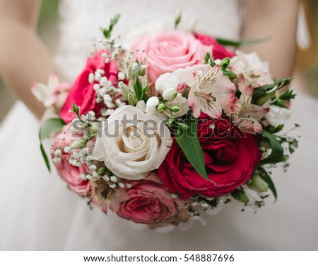 beautiful bouquet in hands of the bride