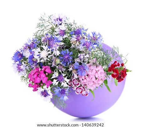 Beautiful bouquet in vase isolated on white - stock photo