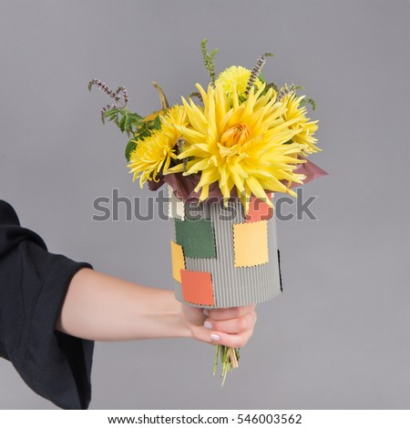 Beautiful bouquet of bright and colorful flowers on a children's holiday