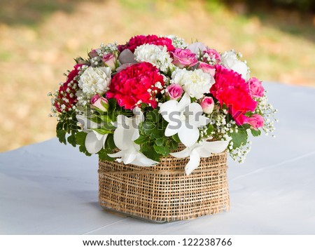 beautiful bouquet of bright wildflowers in basket - stock photo