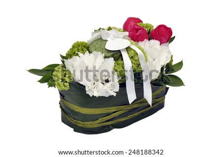 beautiful bouquet of exotic flowers in a basket isolated on white background
