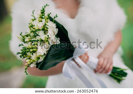 beautiful bouquet of flowers in the hands of the bride