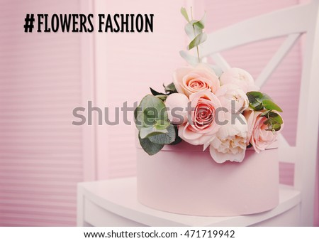Beautiful bouquet of flowers on pink gift box