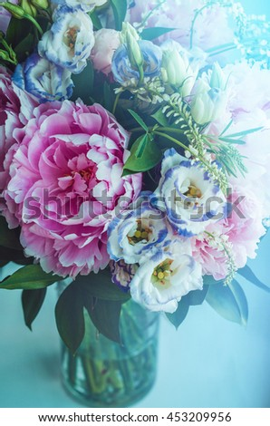 Beautiful bouquet of pink peonies, roses, eustoma flowers in vase on white blue light color background. Spring or summer lovely bouquet. Fresh floral, home decor. Text, copy space - stock photo