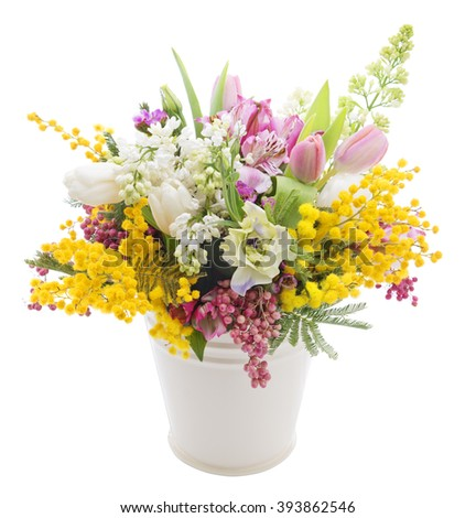 Beautiful bouquet of spring flowers in a can isolated on white background