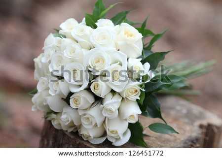 beautiful bouquet of the bride executed from white roses
