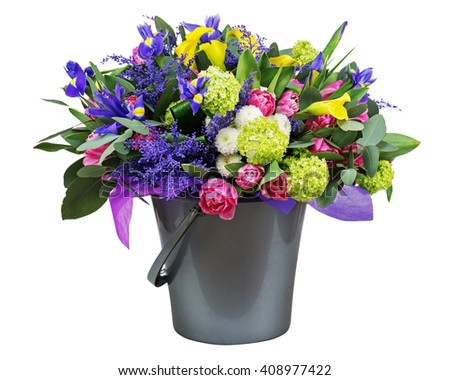 Beautiful bouquet of tulips, iris, alstroemeria, lilies and other flowers in vase isolated on white background.  - stock photo