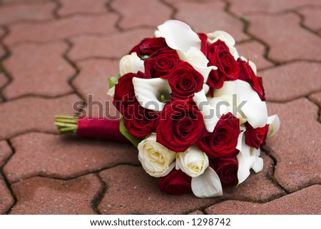 beautiful bouquet of white and red roses with calla lilies - stock photo