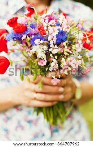 Beautiful bouquet of wild flowers - stock photo