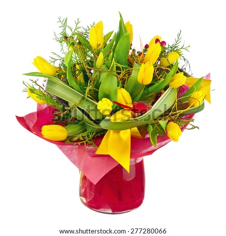 Beautiful bouquet of yellow tulips and other flowers in glass vase isolated on white background. - stock photo