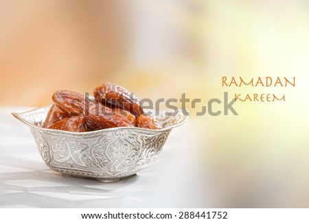 Beautiful bowl full of date fruits symbolizing Ramadan - stock photo