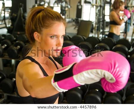 Beautiful boxing girl wearing pink gloves. - stock photo