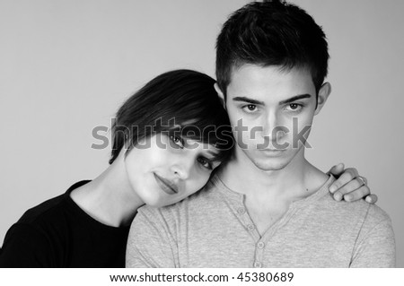 beautiful boy and young woman - stock photo