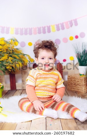 beautiful boy in the room with Easter decorations