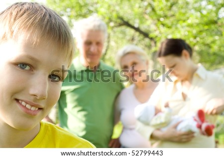 beautiful boy is on the background of his family - stock photo