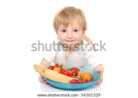 beautiful boy showing the plate with fruits isolated on white.