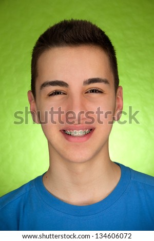 Beautiful Boy with braces - stock photo