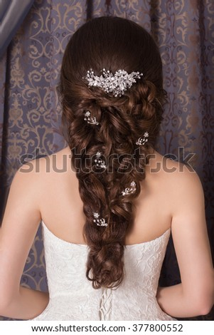 Beautiful bride and beautiful wedding dress. Wedding dress. Wedding decoration. Portrait of a beautiful woman in the image of the bride with hairstyle. - stock photo