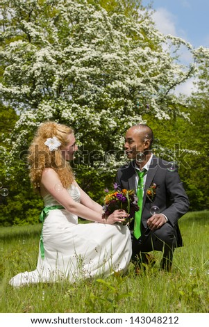 beautiful bride and groom after wedding on a green meadow